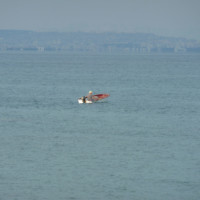 Man in a small motorboat in front of Antalya